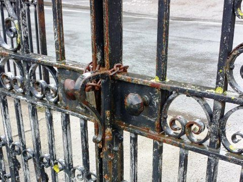 Coedpoeth Memorial Gates - Locking chains damage finishes - locks will be reinstated