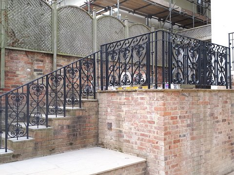 The balustrade around the landing and down the steps are made up of smaller matching panels featuring similar floral details, all adhering to 'the 100mm sphere rule' and stands 1100mm above ground level (900mm above the nose on the steps) to prevent entrapment or a falls.